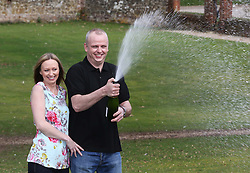 Neil Trotter a  car mechanic and racing driver from Coulsdon, United Kingdom celebrates with  his partner Nicky Ottaway at a hotel in Dorking, United Kingdom, after winning  £108 million (pounds sterling) in the EuroMilllions lottery, Tuesday, 18th March 2014. Picture by Stephen Lock / i-Images