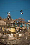 Shoes hang from electrical wires marking gang territory in the slums of Anarba, one of the poorest slums of Juarez, where a ready supply of gang members fuel the ongoing drug war in  Mexico January 15, 2009. The drug war has already claimed more than 40 people since the start of the year. More than 1600 people were killed in Juarez in 2008, making Juarez the most violent city in Mexico.    (Photo by Richard Ellis)