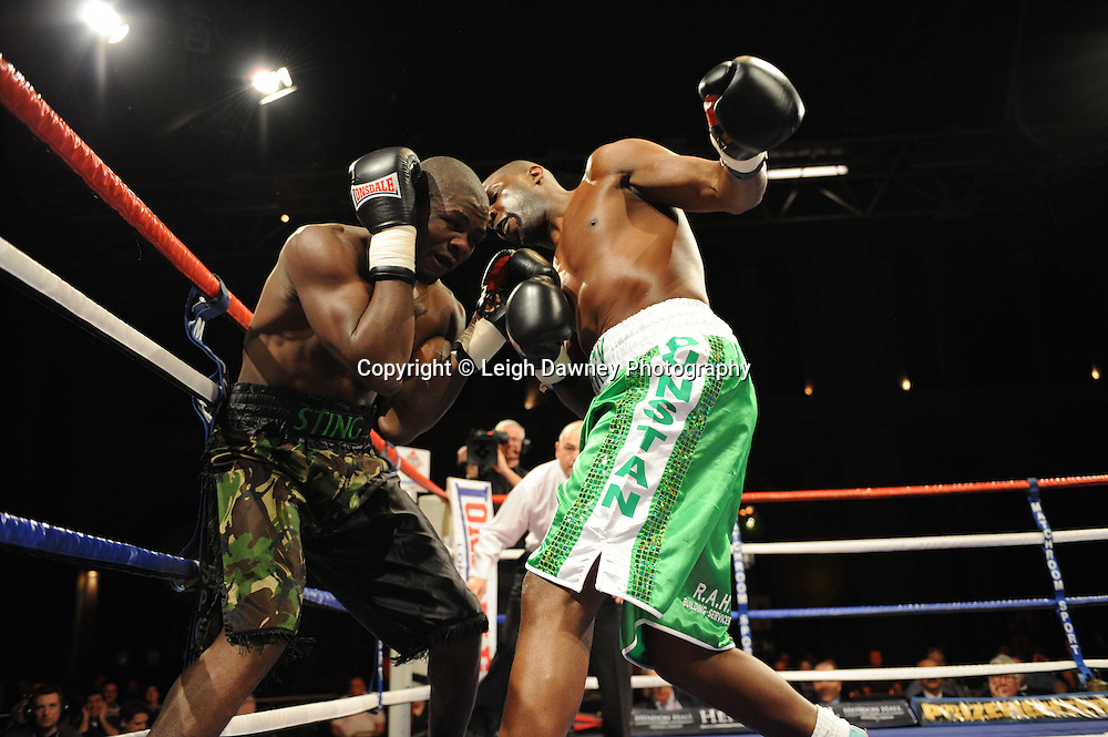 Terry Dunstan (light green shorts) defeats Hastings Rasani on the 9th April 2010 at Alexandra Palace, London. Matchroom Sport. Photo credit: © Leigh Dawney