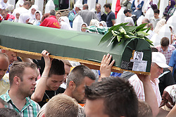 60113379  <br /> A coffin is carried to the Potocari Memorial Centre in Srebrenica, Bosnia and Herzegovina, July 11, 2013. Thousands of in Bosnia and Herzegovina gathered on Thursday at Potocari Memorial Centre near Srebrenica to mourn for victims in the 1995 Srebrenica Massacre. A total of 409 newly-identified victims were buried at the centre on the 18th anniversary of the massacre, putting the numbers of gravestones to over 6000, picture taken Thursday, July 11, 2013.<br /> Photo by imago / i-Images<br /> UK ONLY