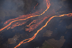 Handout photo of KÄ«lauea Volcano — Lava Channels Feeding Ocean Entries - On Wednesday, May 23, 2018 the Hilo Civil Air Patrol conducted flights over the lower East Rift Zone eruption to assist USGS and Hawai'i County Civil Defense Agency as they respond to the KÄ«lauea eruption. This image shows the scale of the lava channels feeding the ocean entries. Note that lava is overflowing the channels and is on top of slightly older, black lava flows. The visible haze is sulfur dioxide gas that's being emitted from the fissures. Photo by USGS via ABACAPRESS.COM