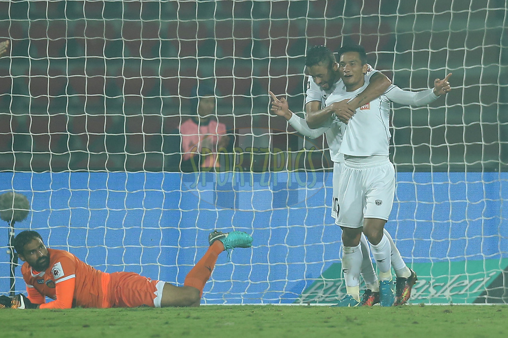 Seiminlen Doungel of Northeast United FC celebrates the goal with team players during match 51 of the Hero Indian Super League between NorthEast United FC and Chennaiyin FC  held at the Indira Gandhi Athletic Stadium, Guwahati India on the 19th January 2018<br /> <br /> Photo by: Deepak Malik  / ISL / SPORTZPICS