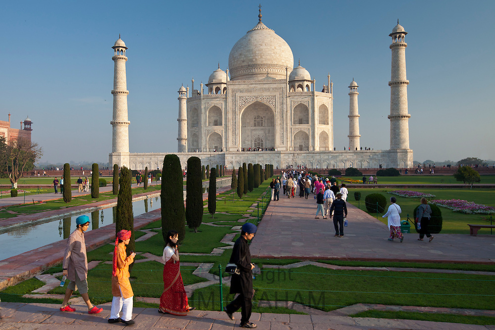 Asian tourists at The Taj Mahal mausoleum southern view Uttar Pradesh, India