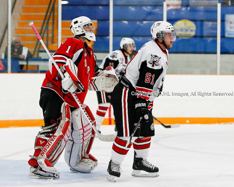 STOUFFVILLE, ON - Oct 4, 2014 : Ontario Junior Hockey League game action between Georgetown and Stouffville, Conor McCollim #1 of the Stouffville Spirit Hockey Club and Blake Jones #61 of the Georgetown Raiders Hockey Club.<br /> (Photo by Brian Watts / OJHL Images)