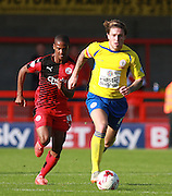 Accrington Stanley striker Josh Windass gets the better of Crawley Town defender Lewis Young during the Sky Bet League 2 match between Crawley Town and Accrington Stanley at the Checkatrade.com Stadium, Crawley, England on 26 September 2015. Photo by Bennett Dean.