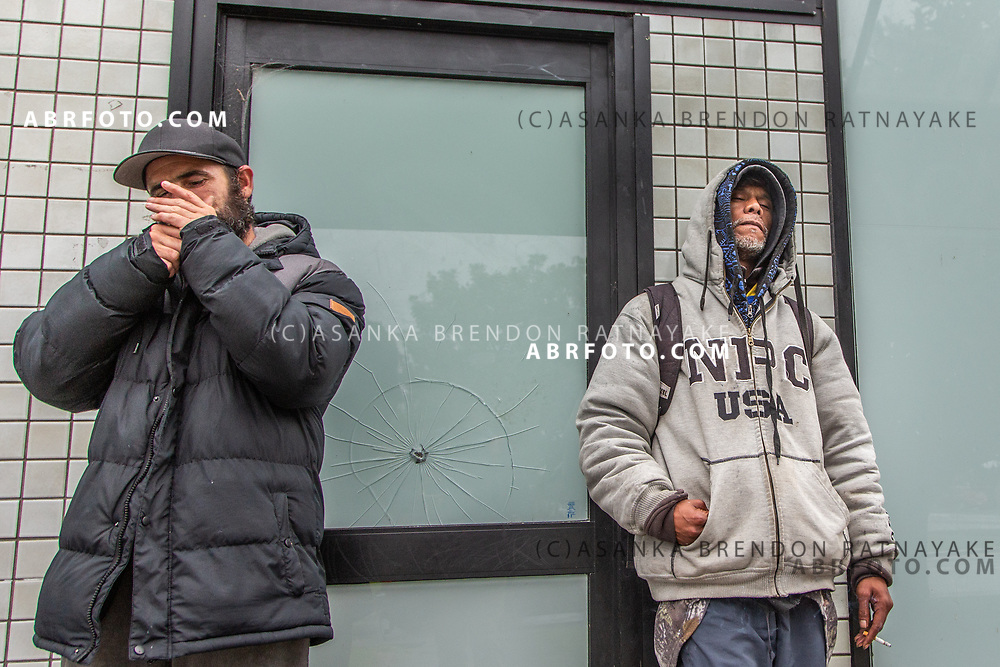 Owen Keane (Left) and Joseph Takairangi (Right) smoking outside the Henderson shops in West Auckland on the 6th of June 2018. Asanka Brendon Ratnayake for The New York Times.
