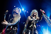 LONDON, ENGLAND - MARCH 31: (L-R) Lexxi Foxxx and Michael Starr of Steel Panther perform live on stage at Brixton Academy on March 31, 2012 in London, United Kingdom.  (Photo by Simone Joyner/Redferns via Getty Images) *** Local Caption *** Michael Starr; Lexxi Foxxx