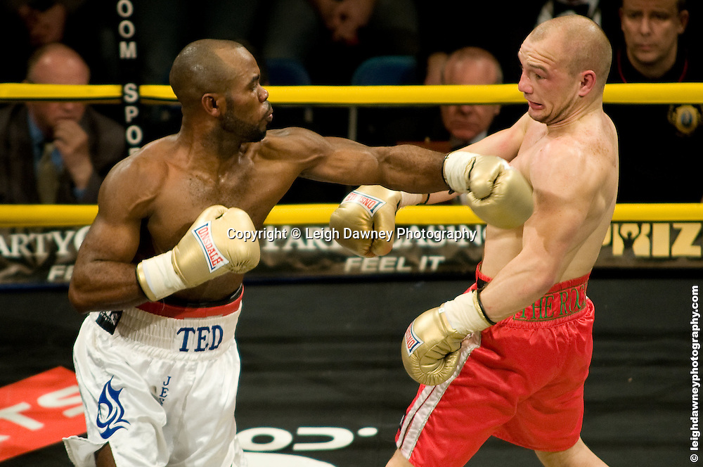 Gavin Rees (red shorts) defeats Ted Bami at London Olympia -  Prizefighter Light Welterweights 4th December 2009 Credit: © Leigh Dawney Photography