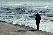 Solitary person walking on the beach, Martha's Vineyard, Massachusetts, USA