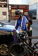 NEW YORK CITY, NEW YORK, MARCH 30, 2016. Caryn Havlik arrives via bicycle for Metal Bones Yoga. The class takes place at 6:30 p.m. on Wednesdays at The Cobra Club in Bushwick, Brooklyn. 03/30/2016. Photo by Donna M. Airoldi/NYC News Service