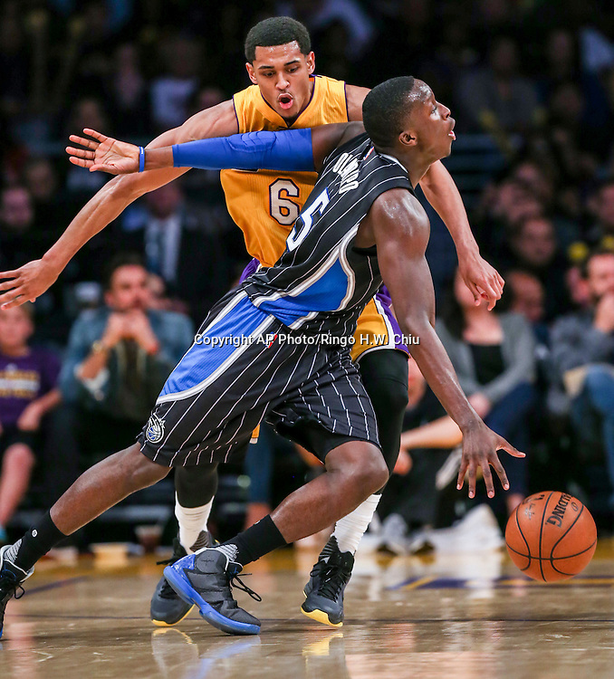 Orlando Magic guard Victor Oladipo, front, drives against Los Angeles Lakers guard Jordan Clarkson during the second half of an NBA basketball game Tuesday, March 8, 2016, in Los Angeles.  Lakers won 107-98. (AP Photo/Ringo H.W. Chiu)