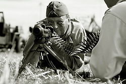 A reenactor portraying a soldier of the German Army (Heer) undergoes weapons training on the (Maschinengewehr 1942)in its Light Machine gun role. He wearing the german army issue undershirt and Overseas cap or Field Cap (Feldmutze)<br /> <br />  17 July 2016<br />  Copyright Paul David Drabble<br />  www.pauldaviddrabble.photoshelter.com