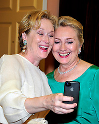 Meryl Streep takes a photo of herself with United States Secretary of State Hillary Rodham Clinton following a dinner honoring the seven 2012 recipients of the Kennedy Center honors at the U.S. Department of State in Washington, DC, USA, on December 01, 2012. The 2012 honorees are Buddy Guy, actor Dustin Hoffman, late-night host David Letterman, dancer Natalia Makarova, and the British rock band Led Zeppelin. Photo by Ron Sachs/ABACAPRESS.COM