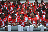 Mississippi players get ready for the team photo during the team's media day, in Oxford, Miss. on Friday, August 1, 2014. Mississippi begins practice Saturday morning and opens the season against Boise State in Atlanta on August 28, 2014. (AP Photo/Oxford Eagle, Bruce Newman)
