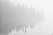 Shoreline reflection in Lyons Lake<br /> Whiteshell Provincial Park<br /> Manitoba<br /> Canada