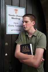 Teenager outside church.