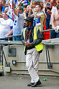 A cool looking steward (?) during the EFL Sky Bet League 2 Play Off Final match between Newport County and Tranmere Rovers at Wembley Stadium, London, England on 25 May 2019.