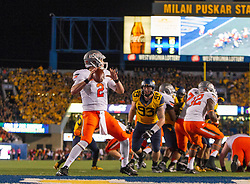 Oct 10, 2015; Morgantown, WV, USA; Oklahoma State Cowboys quarterback Mason Rudolph attempts to throw during the second quarter against the West Virginia Mountaineers at Milan Puskar Stadium. Mandatory Credit: Ben Queen-USA TODAY Sports