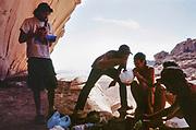 people eating in rocky shade, Middle East Tek, Wadi Rum, Jordan, 2008