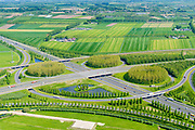 Nederland, Gelderland, Gemeente Zaltbommel, 23-08-2016; verkeersknooppunt Deil, A2 en A15 (vlnr). Parallel aan de A2 de Betuweroute. Klaverturbineknooppunt.<br /> Deil junction, main motorway A15 (Rotterdam Harbour - Germany) crossing motorway A2 to the South.<br /> <br /> aerial photo (additional fee required); luchtfoto (toeslag op standard tarieven); copyright foto/photo Siebe Swart