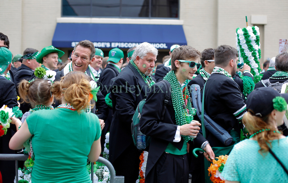 12 March 2016. New Orleans, Louisiana.<br /> The Irish Channel St Patrick's Day parade makes its way along Magazine Street.<br /> Photo©; Charlie Varley/varleypix.com