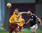 23rd December 2017, Fir Park, Motherwell, Dundee; Scottish Premier League football, Motherwell versus Dundee; Motherwell's Peter Hartley battles for the ball with Dundee's Sofien Moussa