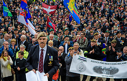 © Licensed to London News Pictures. <br /> 14/4/2017. London, Great Britain. <br /> Robin Horsfall, former 22 SAS and protest organiser during the Justice for Northern Ireland Veterans March in central London.<br /> They are protesting the prosecution of former Service men and women who served in Northern Ireland during the Troubles.<br /> Photo credit: Anthony Upton/LNP