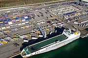Nederland, Zuid-Holland, Rotterdam, 18-02-2015. Ro-Ro Cargo schip voor de kade in de Brittaniehaven. Cobelfret (voorheen Broekman) terminal, opslag en overslag van trailers en vrachtauto's. Rotterdam Car Terminal (RCT).<br /> Roll on, Roll off cargo ship (Ro-Ro) on the quay at the  Brittaniehaven, Rotterdam Car Terminal (RCT).<br /> luchtfoto (toeslag op standard tarieven);<br /> aerial photo (additional fee required);<br /> copyright foto/photo Siebe Swart