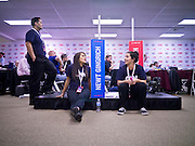 "22 FEBRUARY 2012 - MESA, AZ:  Volunteers wait for the Arizona Republican Presidential Debate to end in the ""Spin Room."" Some of the candidates and their representatives visited the ""Spin Room"" after the debate to discuss how well their candidates did in the two hour debate, the last one before the Arizona and Michigan primaries next week and ""Super Tuesday"" on March 6.   Photo  PHOTO BY JACK KURTZ"