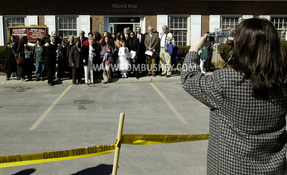 Times Herald-Record/TOM BUSHEY.Many of the 21 gay couples married by Mayor Jason West in New Paltz yesterday pose for a photograph outside Village Hall yesterday afternoon..Feb. 27, 2004.