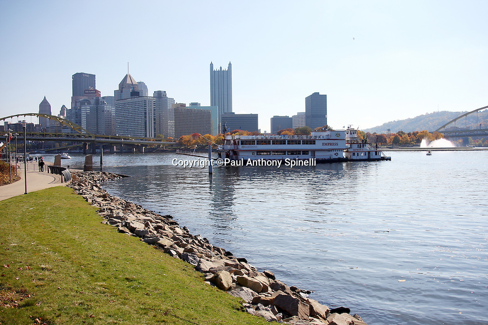 A ferry brings fans across the river with the city skyline in the background as the Pittsburgh Steelers get set to play the NFL football game against the Minnesota Vikings, October 25, 2009 in Pittsburgh, Pennsylvania. The Steelers won the game 27-17. (©Paul Anthony Spinelli)