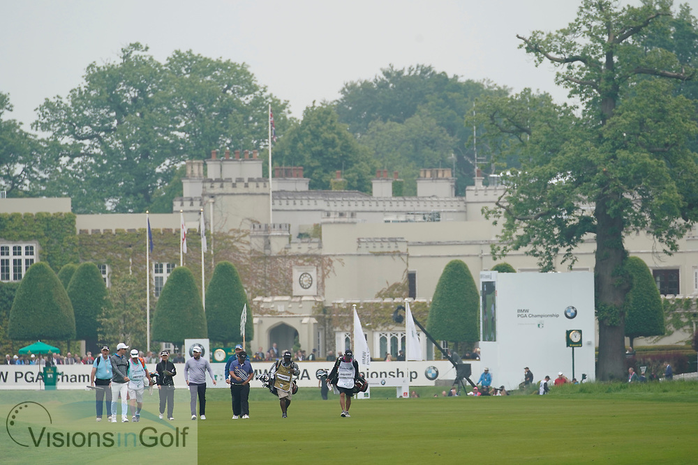 1st hole clubhouse and advertising boards on the tee grandstands bleachers full of crowds of fans people spectators scenic and general view<br /> On the first day