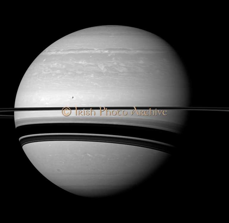 Even in a peaceful looking scene such as this one of Saturn and its moon Tethys, the Cassini spacecraft reveals clues about how Saturn is ever-changing.