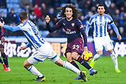 Matteo Guendouzi of Arsenal (29) passes the ball forward during the Premier League match between Huddersfield Town and Arsenal at the John Smiths Stadium, Huddersfield, England on 9 February 2019.