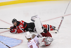 Oct 10; Newark, NJ, USA; New Jersey Devils center Patrik Elias (26) is called for goaltender interference after running into Carolina Hurricanes goalie Cam Ward (30) during the third period at the Prudential Center. The Devils defeated the Hurricanes 4-2.