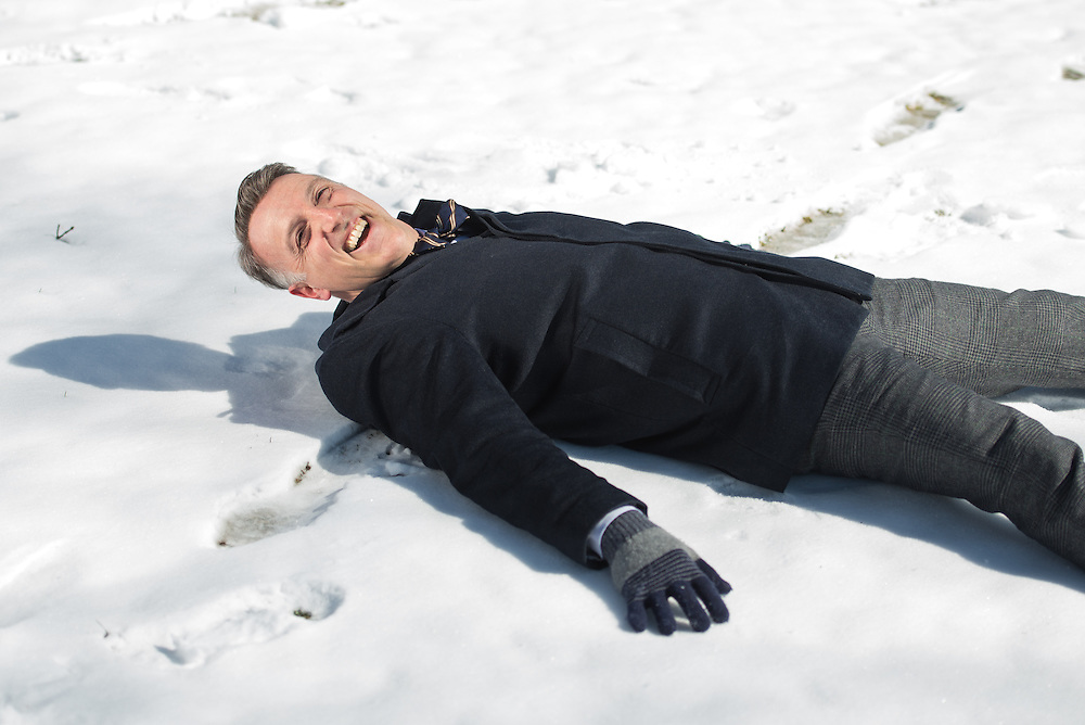 2/12/16 – Medford/Somerville, MA – Dean of Undergraduate Admissions Lee Coffin makes a snow angel on Friday, Feb. 12, 2016. (Evan Sayles / The Tufts Daily)