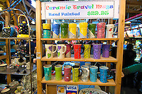 You pay a premium for a hand crafted/painted unique ceramic travel mug at granville island...