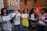Roma 24 Giugno 2015<br /> Gli insegnanti protestano contro le riforme della scuola di Renzi, vicino  al Senato, dove giovedi il Governo Renzi ha deciso di votare la fiducia alla legge.<br /> Rome June 24, 2015<br /> The teachers are protesting against Renzi's school reforms, , close to the Senate, where the government Renzi, thursday decided to vote confidence to the law.