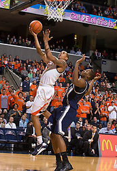 Virginia guard Sylven Landesberg (15) finishes a layup against Xavier.  The #22 ranked Xavier Musketeers defeated the Virginia Cavaliers 84-70 at the John Paul Jones Arena on the Grounds of the University of Virginia in Charlottesville, VA on January 3, 2009.