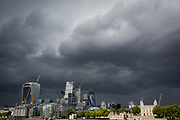 Storm clouds gather and dark times are ahead for the modern City of London (with the Norman-era Tower of London, right), on 14th September 2017, in London, England. The City is the historical financial district founded by the Romans in the 1st Century but faces a post-Brexit financial uncertainty.