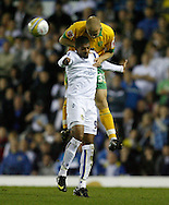Leeds - Monday October 19th, 2009: Jermaine Beckford (L) of Leeds United and Jens Berthel Askou of Norwich City during the Coca Cola League One match at Elland Road, Leeds. (Pic by Paul Thomas/Focus Images)..