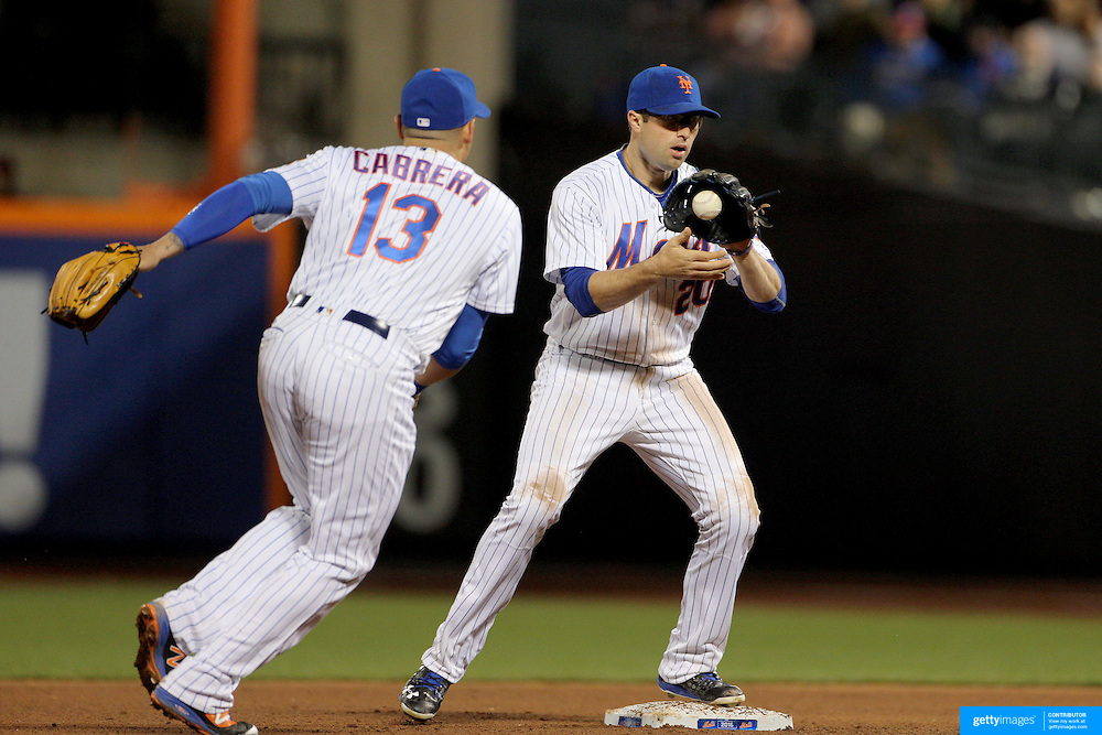 NEW YORK, NEW YORK - APRIL 27:  Double play combination shortstop Asdrubal Cabrera #13 of the New York Mets tosses the ball to second baseman Neil Walker #20 of the New York Mets for a double play during the New York Mets Vs Cincinnati Reds MLB regular season game at Citi Field on April 27, 2016 in New York City. (Photo by Tim Clayton/Corbis via Getty Images)