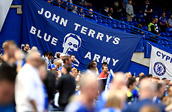 A banner reads John Terry's Blue Army in the stands
