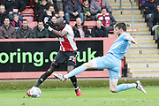 Sanmi Odelusi and Chris Stokes during the EFL Sky Bet League 2 match between Cheltenham Town and Coventry City at LCI Rail Stadium, Cheltenham, England on 28 April 2018. Picture by Antony Thompson.