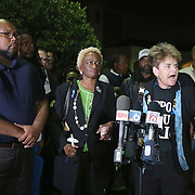 Commissioner Patty Sheehan speaks during a vigil to honor deceased Orlando Police officer Master Sgt. Debra Clayton who was shot and killed as she attempted to stop and question accused gunman Markeith Loyd, at an Orlando Walmart, on January 10, 2017 in Orlando, Florida. Orange County deputy Norm Lewis who was also killed on his motor patrol while responding to Clayton's shooting was also honored.  (Alex Menendez via AP)