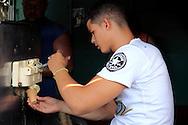 Serving ice cream in Alquizar, Artemisa Province, Cuba.
