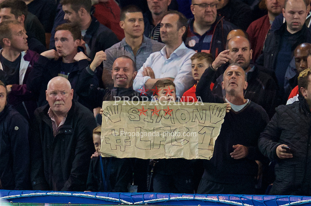 "LONDON, ENGLAND - Friday, September 16, 2016: A Liverpool supporter with a banner ""Simon LFC 1"" for goalkeeper Simon Mignolet during the FA Premier League match against Chelsea at Stamford Bridge. (Pic by David Rawcliffe/Propaganda)"