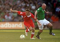 Photo: Paul Thomas.<br />Republic of Ireland v Wales. European Championships 2008 Qualifying. 24/03/2007.<br /><br />Craig Bellamy (L) of Wales battles with Lee Carsley.