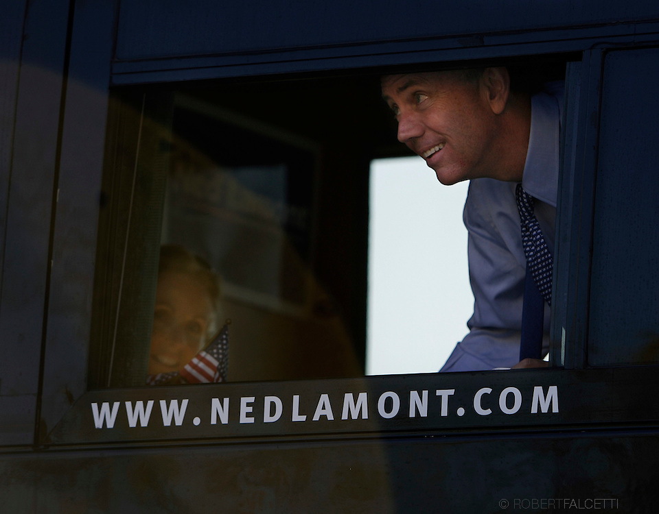 HARTFORD, CT - NOVEMBER 5: Democratic Senate hopeful Ned Lamont looks out a window of his campaign bus as his wife Annie looks on after they participated in the Connecticut Veterans Day Parade November 5, 2006 in Hartford, Connecticut. Lamont is in a tight race for Senate against incumbent Sen. Joseph I. Lieberman.  (Photo by Bob Falcetti/Getty Images)