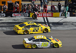 March 4, 2018 - Las Vegas, NV, U.S. - LAS VEGAS, NV - MARCH 04: Joey Logano (22) Team Penske Pennzoil Ford Fusion and Ryan Blaney (12) Team Penske Ford Fusion drive on pit row before making a pit stop during the Monster Energy NASCAR Cup Series Pennzoil 400 on March 04, 2018 at Las Vegas Motor Speedway in Las Vegas, NV. (Photo by Chris Williams/Icon Sportswire) (Credit Image: © Chris Williams/Icon SMI via ZUMA Press)